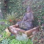 Janette West Hands on Feet Reflexology - garden
